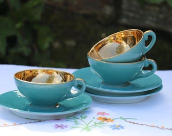 Set of 3 beautiful French Vintage tea or coffee cups and saucers. Gold leaf interior. French Vintage Chic