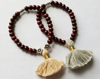 Rosewood stretchable beaded bracelets with tassel.