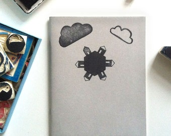 """1 grey blank notebook with lovingly illustrated cover """"Better World at home"""""""