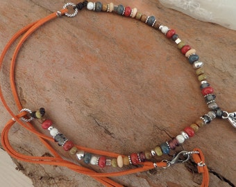 Necklace with suede and pieces of pottery and metal
