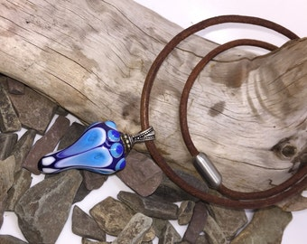 Necklace with leather strap and blue pendant