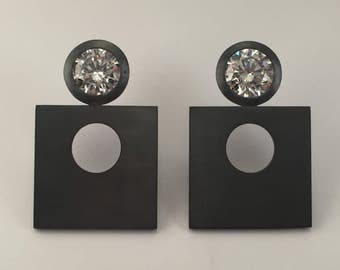 burnished silver earrings and cubic zirconia