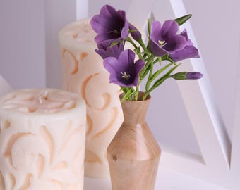Purple bells in a wooden vase