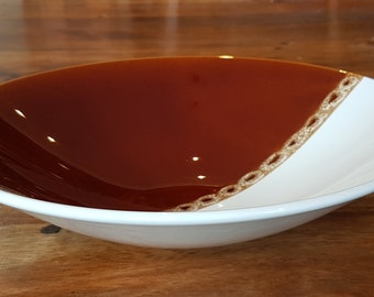 Glamorous, glossy, large bowl by Poole Pottery, made in England in the 1960's - 1970's. Modernist brown and white two tone pattern, British.
