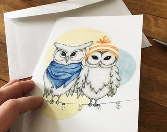 Greeting card representing two in love owls perched on a Garland of lights - performed the fine tip and Watercolour