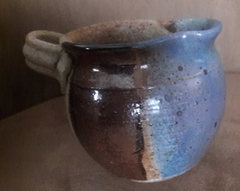 Rustic hand thrown small ceramic pitcher