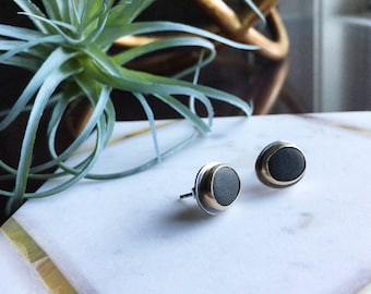 Sterling silver black beach stone studs set in 14K gold bezel.