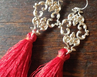 Red tassel earrings. Silk tassel earrings hanging from silver filigree design pendant and sterling silver French ear wires.