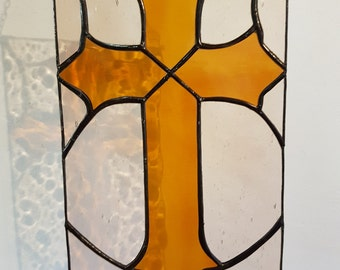 Tiffany stained glass suncatcher of cross in colored glass to hang as window decoration or nice wall ornament. Religious suncatcher in glass