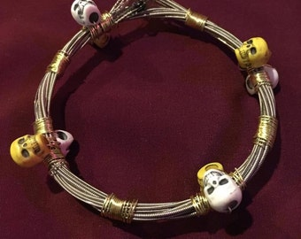 Guitar String Bracelet - White and Yellow Candy Skull