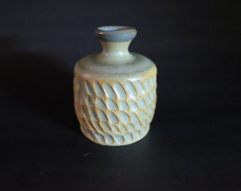 Hand thrown and carved small bottle