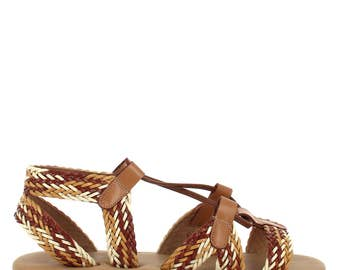 Ceresnia handcrafted strappy flats with trendy lace-up.