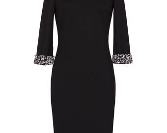 Little black dress with attachable beaded trim to take the dress from day to night.
