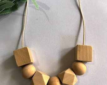 Natural geometric wooden bead necklace