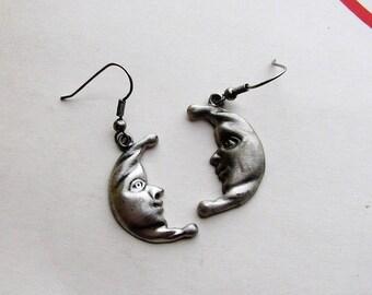 vintage man in the moon earrings . silver tone pewter on french hooks, pierced ears
