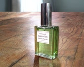 Green Sun, All Natural Perfume Oil with notes of cool citrus, fresh green leaves and rich amber