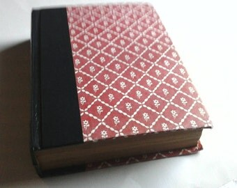 booksafe made  from Reader's Digest condensed book , lined with news priint  looking butterflys