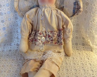 Angel rag doll with antique quilt wings