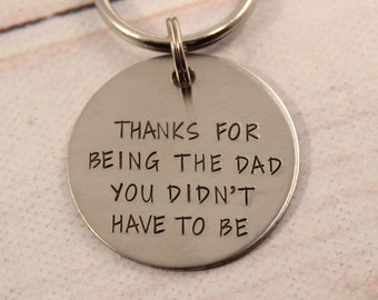 Thanks for being the dad you didn't have to be - Hand stamped, personalized stainless steel keychain.