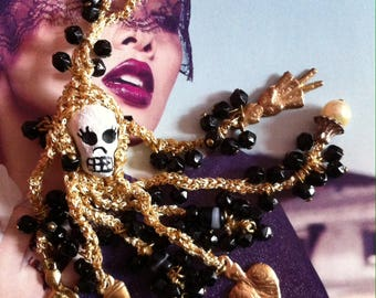 Goldy skull with Mexican milagro drops