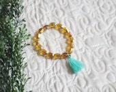 Brown Mirrored Glass Bead Stretch Layering Bracelet with Aqua Tassel