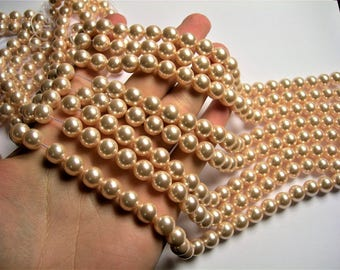 Shell pearl 10 mm round  light peach pearl  1 full strand - 39 beads - SPT45