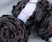 10 balls of L'Atelier Custom Yarn Black Pink and Green