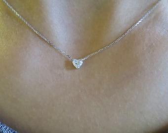 14k white gold heart shape diamond pendent.