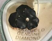 14K black enameled pansy with diamond center     VJSE