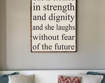 She is clothed in strength and dignity and laughs without fear of the future
