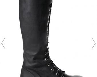 made to order knee high boots with a flat/platform instead and have flames like second picture