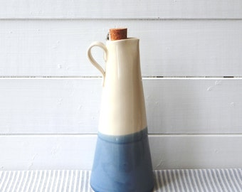 Maple syrup bottle, cream and blue pottery