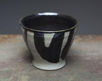 Black glazed tea cup, wood fired stoneware ceramic pottery tea bowl