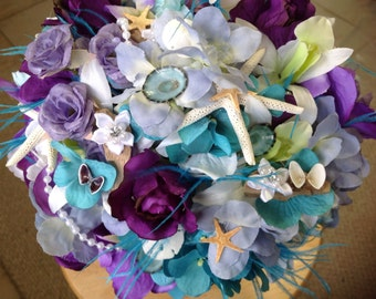 Beach Wedding Seashell Lavender and Purple Bridal Bouquet with Roses Hydrangeas Driftwood Orchids Starfish and Diamond trim