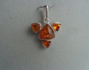 Amber stones set in .925 silver pendant.