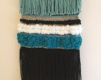 Turquoise woven wall hanging