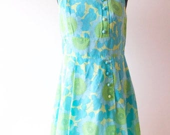 Green blue flower dress with pleats from the sixties