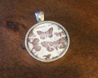 Butterflies and moths resin pendant