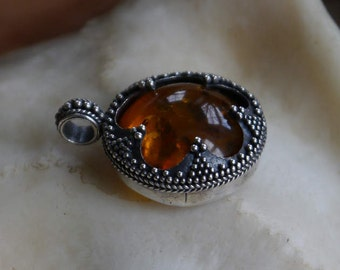 viking amber ,silver filligree hand crafted.two crowns holding amber all