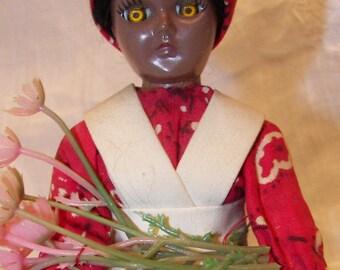 Vintage West Indies plastic sleepy-eye doll, 1960's