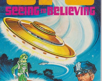 Two vintage UFO coloring books - Seeing is believing and Space Strangers
