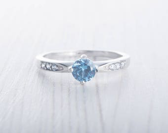 Natural Blue Topaz Solitaire engagement ring available in sterling silver or white gold