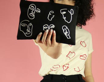 Faces Print Clutch Bag Pouch - White on Black