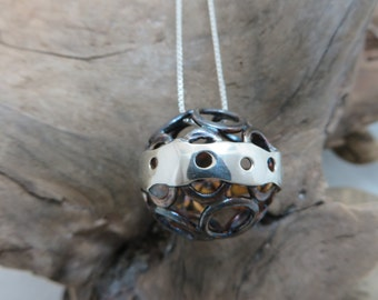 Spherical oxidized sterling silver pendant