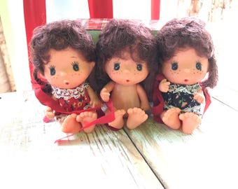 Vintage 60s dolls with freckles / seated dolls / brunette with pig tails and ribbons/ flower dresses / HongKong