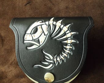 Fishbone, four inch round leather topped tin and leather pouch.