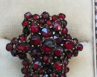 A Bohemian Garnet Ring Victorian Star Shaped 9k Gold