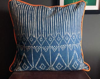 Blue and White Modern Patterned Cushion with Bright Orange Piping