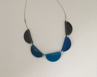 Statement necklace with five half circles in different shades of blue and grey, sterling or plated chain