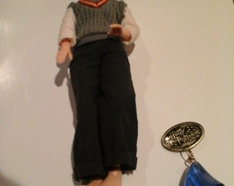 harry potter figure with magic blue stone with secret message inside
